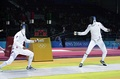 Russian Igor Turchin (left) and American Weston Kelsey (right) duel in second round of men's individual épée