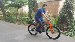 A man riding an electric bicycle