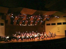 Aldemaro Romero directing the Municipal Symphony Orchestra of Caracas, at the celebration of the 50th anniversary of Dinner in Caracas