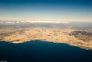 Aerial view of the Athens urban area and the Saronic Gulf.