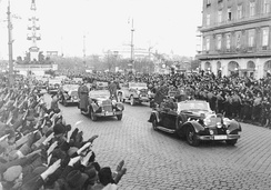 Hitler's motorcade with FBK and RSD escort cars to the left and right behind his car, as they head towards the city center of Vienna in 1938