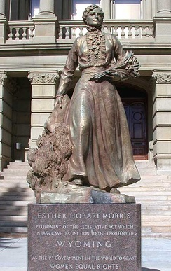 Statue of Esther Hobart Morris in front of the Wyoming State Capitol