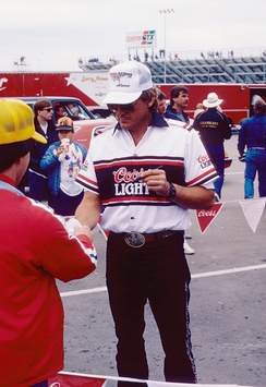 Signing autographs at a 1987 NHRA event