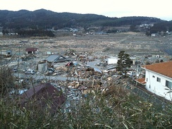 The city of Rikuzentakata, Iwate Prefecture, suffered extensive damage from the tsunami, with almost the entirety of the lower area of the city being destroyed.