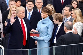 Donald Trump using the Lincoln Bible (being held by wife Melania Trump, with his personal Bible on top of it) to take oath of office at his inauguration.