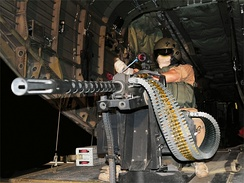 A German Army ramp gunner mans an M3M on board a CH-53 helicopter