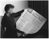 Roosevelt with the Universal Declaration of Human Rights, which includes Franklin Roosevelt's Four Freedoms.