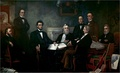 Abraham Lincoln met with his Cabinet for the first reading of the Emancipation Proclamation draft (July 26, 1862).