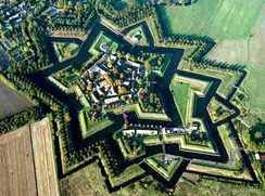 Fort Bourtange, a bastion fort, was built with angles and sloped walls specifically to defend against cannon.