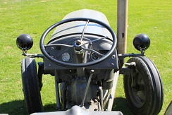 Steering wheel and front wheels of a farm tractor