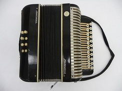 A button key accordion made by the company Marrazza in Italy. It was brought by Italian immigrants to Australia as a reminder of their homeland.