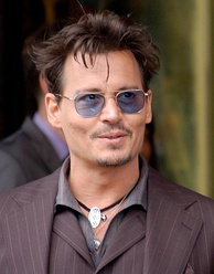 Depp at Jerry Bruckheimer's ceremony to receive a star on the Hollywood Walk of Fame in June 2013