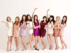 Girls' Generation posing for an LG Cinema 3D TV commercial in 2012
