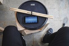 Using a metronome with a practice pad is a common way to practice drum rudiments.