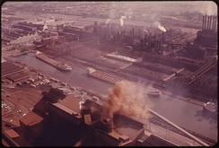 Lake freighters maneuver in the canal to unload ore at the plant, 1973