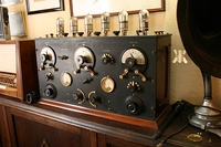 Early 6 tube TRF receiver from around 1920. The 3 large knobs adjust the 3 tuned circuits to tune in stations
