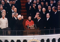 Nixon is sworn in as the 37th President by Chief Justice Earl Warren on January 20, 1969, with the new First Lady, Pat, holding the family Bibles.