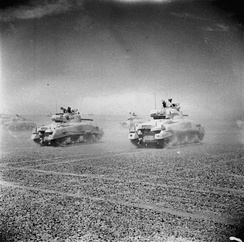 Sherman tanks of the Eighth Army move across the desert