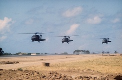 UH-60A Black Hawks over Port Salinas during the invasion of Grenada, 1983. The conflict saw the first use of the UH-60 in combat.