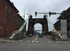 View west from the east end of the bridge in downtown Wheeling. Note the multiple warning signs restricting access.