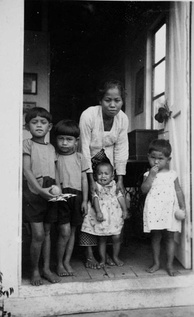A baboe and the children in her care in the Dutch East Indies (now Indonesia), 1934