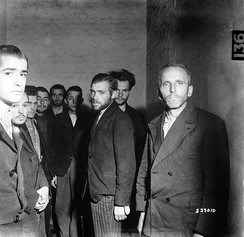German Gestapo agents arrested after the liberation of Liège, Belgium, are herded together in a cell at the Citadel of Liège, October 1944