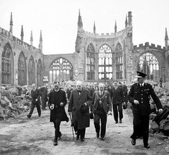 Churchill walks through the ruins of Coventry Cathedral with Alfred Robert Grindlay, 1941.