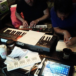 People composing music using synthesizers in 2013.