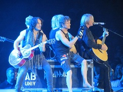 Def Leppard playing an acoustic set at the Allstate Arena in Rosemont, Illinois on 19 July 2012.
