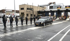 Officers of the Metropolitan Transportation Authority and a state police honor guard saluting Cuomo's hearse as it passes through the Queens Midtown Tunnel, January 6, 2015