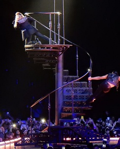 "Madonna performing ""HeartBreakCity"" on top of the steel spiral staircase."