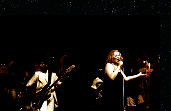 Mina backed by the orchestra conducted by bassist/arranger Pino Presti on occasion of her last public performances at the Bussoladomani Theatre in 1978.