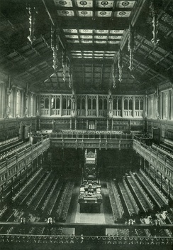 The old House of Commons chamber, showing dark veneer on the wood, which was purposely made much brighter in the new chamber.