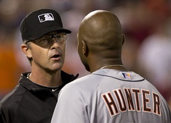 Umpire Paul Nauert calms Hunter following an altercation in Baltimore on May 12, 2014.