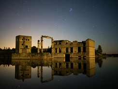 Derelict Rummu quarry utility buildings in the water at night, September 2014