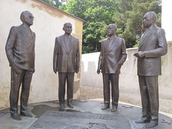 "The monument ""Homage to the Founding Fathers of Europe"" in front of Schuman's house in Scy-Chazelles by Russian artist Zurab Tsereteli, unveiled 20 October 2012. The statues represent the four founders of Europe – Alcide de Gasperi, Robert Schuman, Jean Monnet and Konrad Adenauer."