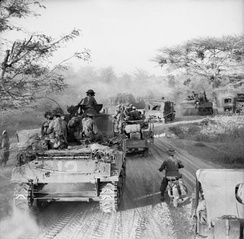 Sherman tanks and trucks of 63rd Motorised Brigade advancing on Meiktila, March 1945.
