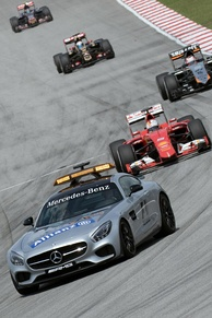 Mercedes-AMG GT safety car leading the field around the circuit at reduced speed