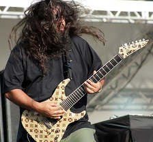 Stephen Carpenter playing a 7-string electric guitar in 2009
