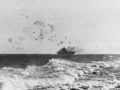 The aircraft carrier USS Enterprise (CV-6) under aerial attack during the Battle of the Eastern Solomons