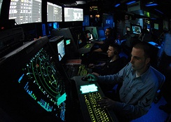 An air traffic controller works approach control in Carrier Air Traffic Control Center aboard the Nimitz-class aircraft carrier USS Abraham Lincoln.
