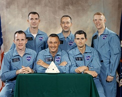 Official portrait of prime and backup crews for AS-204, as of April 1, 1966. The backup crew (standing) of McDivitt (center), Scott (left) and Schweickart were replaced by Schirra, Eisele and Cunningham in December 1966.