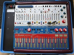 The Buchla Music Easel included a number of fader-style controls, switches, patch cord-connected modules, and a keyboard.