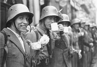 Volunteers of the Sudeten German Free Corps (German: Sudetendeutsches Freikorps) receiving refreshments from the local population in the city of Eger (Czech: Cheb)