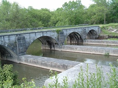 Derelict aqueduct over Nine Mile Creek north of Camillus, New York, built in 1841 and abandoned c. 1918; one of 32 navigable aqueducts on the Erie Canal, it has since been restored.
