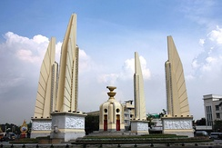 Bangkok's Democracy Monument: a representation of the 1932 Constitution sits on top of two golden offering bowls above a turret.