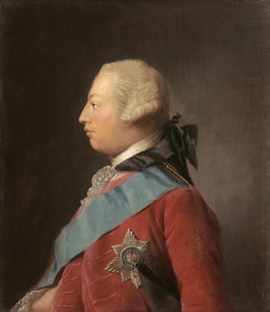 Quarter-length portrait in oils of a clean-shaven young George in profile wearing a red suit, the Garter star, a blue sash, and a powdered wig. He has a receding chin and his forehead slopes away from the bridge of his nose making his head look round in shape.