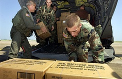 Soldiers load hundreds of Meals, Ready-to-Eat and water onto a CH-47 Chinook helicopter at Ellington Field, Texas