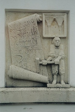 Stone relief carving of the Italian Master in Kaisersteinbruch. Scroll with the names Maderno, Ferrethi, Regondi, della Torre and Passerini, while to the upper right is a quotation from Neugebäude Castle.