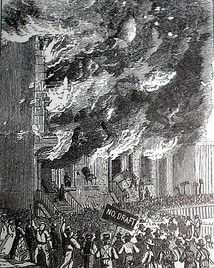 Rioters attacking a building during the New York anti-draft riots of 1863